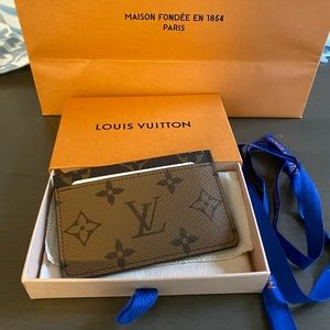 NWT Reverse LV Card Holder